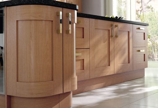 Tewkesbury shaker Kitchen - oak effect island quadrant doors, from Riley James Kitchens Stroud