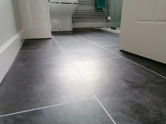 Cam Bathroom - Tarkett Flooring, Sandstone Black - from Riley James Bathrooms Stroud