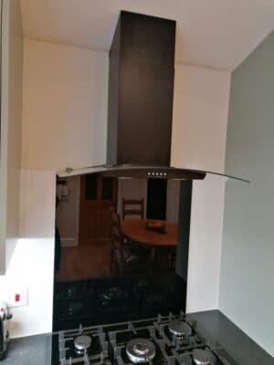 Riley James Malborough Sage Green Installation Curved Extract and Splashback - Riley James Kitchens Stroud