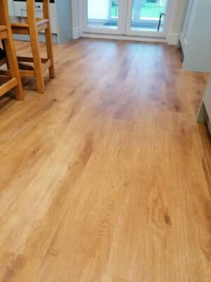 Riley James Malborough Sage Green Installation Lifestyle LVT Flooring 1 - Riley James Kitchens Stroud